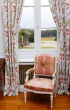 Armchair close to window Royalty Free Stock Image