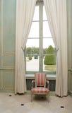 Armchair close to window Royalty Free Stock Photos
