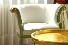 Armchair with coffee table Royalty Free Stock Image