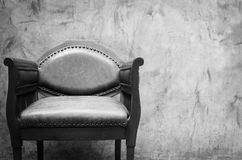 Armchair with concrete wall background , black and white Royalty Free Stock Image