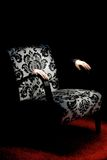 Armchair in a dark room Royalty Free Stock Images