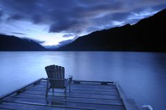Armchair on a deck at dusk Royalty Free Stock Image