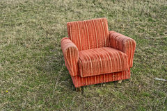 Armchair in the field Royalty Free Stock Photos