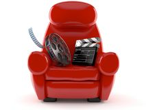 Armchair with film slate and movie real. On white background Stock Photography