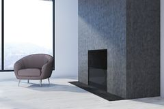 Armchair and a fireplace. Beige armchair standomg next to a massive fireplace in a room with panoramic windows and a wooden floor. 3d rendering mock up Royalty Free Stock Photos