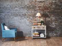 Armchair in front of brick wall Stock Images