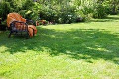 Armchair in the garden stock photos