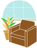Armchair infront of Bay Window accented by plant Royalty Free Stock Photo