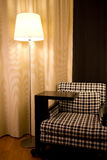 Armchair and lamp in hotel Royalty Free Stock Photos