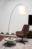 Armchair and lamp in the room Royalty Free Stock Images