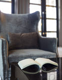 Armchair in living room. With pillow and book on the table Royalty Free Stock Photography