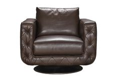 Armchair is made of genuine leather. Cozy chair made of genuine leather, studio shot on a white background Royalty Free Stock Photography