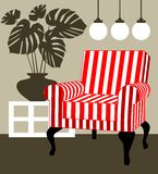 Armchair and monstera deliciosa Royalty Free Stock Photography