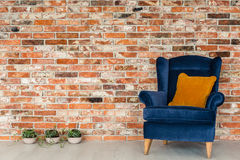 Armchair with orange pillows Royalty Free Stock Photo