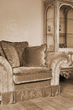 Armchair with pillows Stock Images
