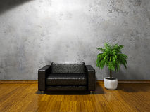 Armchair with pillows. Black leather armchair  near the concrete wall Royalty Free Stock Photo