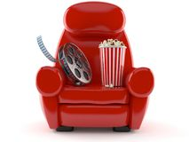 Armchair with popcorn and film reel. Isolated on white background Royalty Free Stock Photo