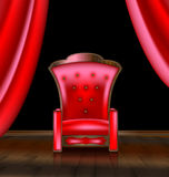 Armchair in the red room Royalty Free Stock Photos