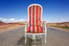 Armchair on the road Stock Photography