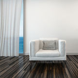 Armchair with seascape view and curtained window Royalty Free Stock Photo