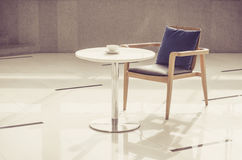 Armchair and table with coffee cup Royalty Free Stock Photography