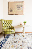 Armchair,table and hand-made poster royalty free stock photography
