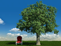 Armchair and tree in the meadows Stock Image