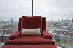 Armchair in a window with panoramic London view. Armchair in a floor to ceiling window with panoramic London views Royalty Free Stock Images