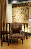 Modern Plaid Armchair - Rock Wall Background Royalty Free Stock Photography