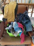 Armshair with wrinkled clothes ready to iron. Armchair with wrinkled clothes ready to iron Stock Images