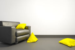 Armchair with yellow pillows Royalty Free Stock Photography