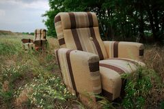 Armchairs. Two discarded armchairs on a field Stock Photography