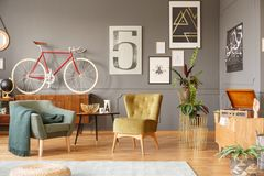 Armchairs, coffee table and bike royalty free stock photo