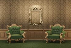 Armchairs and Empty golden frame on a wall. Royal apartment. Luxurious interior. Baroque furniture Royalty Free Stock Image