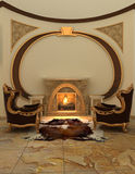 Armchairs near fireplace in modern interior. Royalty Free Stock Photography