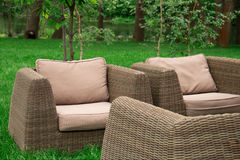Armchairs on the river bank. Sofa and armchairs stand on the river bank in summer Stock Images