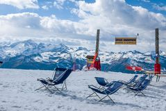 Armchairs at the top of the snowy mountain Stock Images