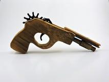 Arme à feu en bois de jouet photos stock