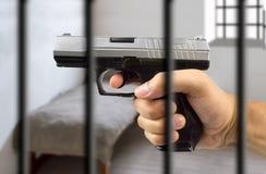 Arme à feu en prison Images libres de droits