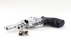 Arme à feu et balles de Chrome Photographie stock libre de droits