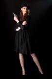 Arme à feu noir de fille de film Photographie stock libre de droits