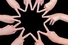 Arme von Mädchen übergibt die Herstellung des zehn gezeigten Sternes Lizenzfreie Stockfotos