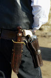 Armed 3. A cowboy waits his turn at a shooting competition Royalty Free Stock Photo
