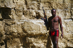 Armed african rebel with gun Stock Image