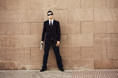 Armed agent ready. Armed agent over urban background stock photo