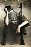 The armed Arabian woman terrorist stock photos