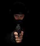 Armed assassin with motorcycle helmet aiming royalty free stock photo