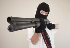 Armed assault attack. Shotgun armed attacker wearing balaclava Stock Photos