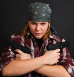 Armed bandit girl Royalty Free Stock Photo