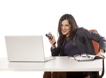 Armed businesswoman Stock Image